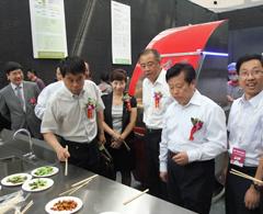 大明机器人炒菜机出品受到陕期西省领导高度关注